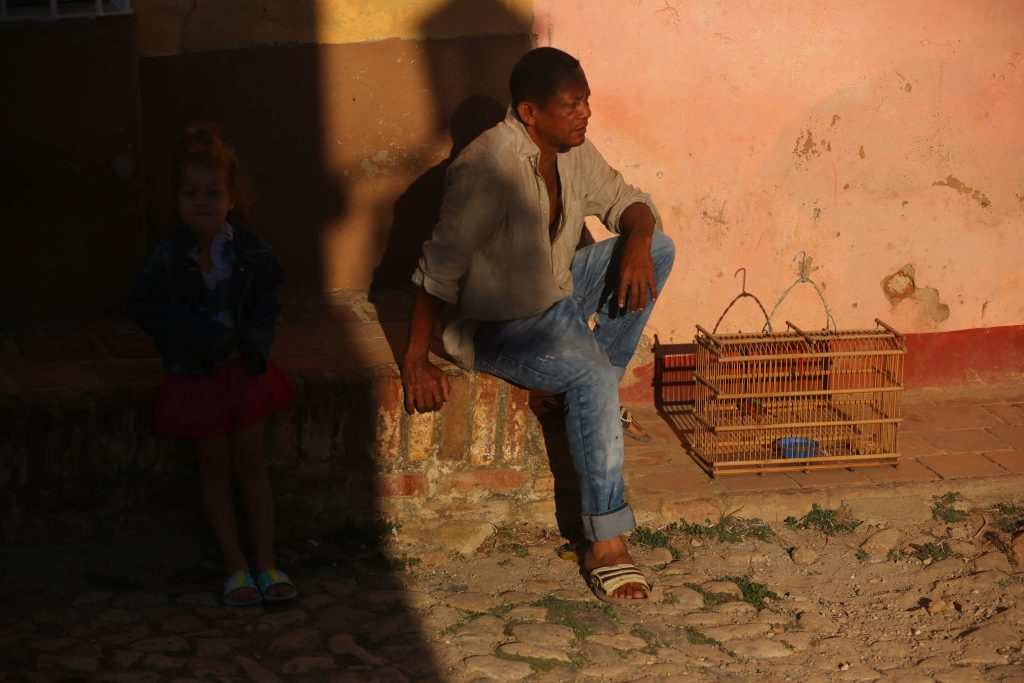 cuban man with bird